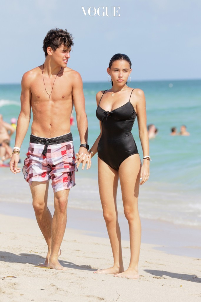 Jack Gilinsky and Madison Beer spend another day at the beach in Miami Beach, FL. Madison wore a black one piece swimsuit as she took a swim in the ocean with Jack. Pictured: Jack Gilinsky, Madison Beer Ref: SPL1202188  311215   Picture by: Pichichi / Splash News Splash News and Pictures Los Angeles:310-821-2666 New York: 212-619-2666 London:870-934-2666 photodesk@splashnews.com