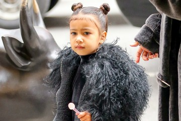 Kim Kardashian seen wearing her fake lip piercing while out and about with her kids North West and Saint West and her friend Jonathan Cheban in New York City, they where arriving at Cipriani in SoHo.  Pictured: North West Ref: SPL1433278  010217   Picture by: Felipe Ramales / Splash News  Splash News and Pictures Los Angeles:	310-821-2666 New York:	212-619-2666 London:	870-934-2666 photodesk@splashnews.com