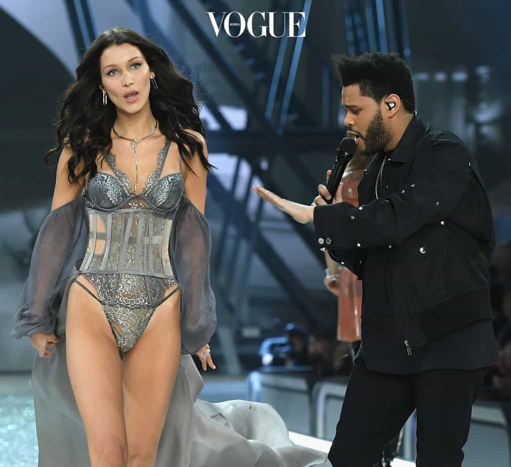 PARIS, FRANCE - NOVEMBER 30:  Bella Hadid walks the runway as The Weekend performs during the 2016 Victoria's Secret Fashion Show on November 30, 2016 in Paris, France.  (Photo by Dimitrios Kambouris/Getty Images for Victoria's Secret)