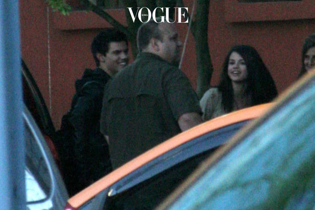 Selena Gomez hugs Taylor Lautner's dad as they head out for dinner, Vancouver. Pictured: Selena Gomez, Daniel and Taylor Lautner Ref: SPL100012 120509  Picture by: Splash News Splash News and Pictures Los Angeles: 310-821-2666 New York: 212-619-2666 London: 870-934-2666 photodesk@splashnews.com