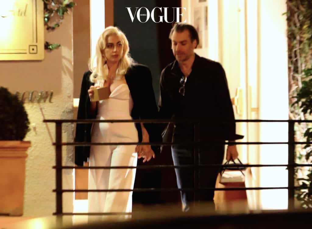 EXCLUSIVE: *PREMIUM EXCLUSIVE RATES APPLY* *NO WEB UNTIL 1PM PST, MARCH 7, 2017* Lady Gaga gets intimate with her new romance and manager Christian Carino as they leave a celebrity-packed party at the Sunset Tower Hotel in West Hollywood. The loved up couple were the last to leave the party, holding hands as they emerged at about 4am. Gaga had Christian's jacket draped around her as they kissed passionately while waiting at the valet. Other stars at the party included  Lilly Collns, Jessica Alba, Dylan Mcdermott, Tommy Hilfiger, and Christina Aguilera Pictured: Lady Gaga Ref: SPL1456795  060317   EXCLUSIVE Picture by: Splash Splash News and Pictures Los Angeles:310-821-2666 New York:212-619-2666 London: 870-934-2666 photodesk@splashnews.com