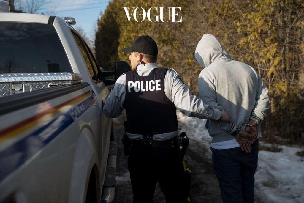 HEMMINGFORD, QUEBEC - FEBRUARY 22: A man claiming to be from Sudan is apprehended by Royal Canadian Mounted Police officers after he crossed the U.S.-Canada border into Canada, February 22, 2017 in Hemmingford, Quebec. In the past month, hundreds of people have crossed Quebec land border crossings in attempts to seek asylum and claim refugee status in Canada. (Photo by Drew Angerer/Getty Images)