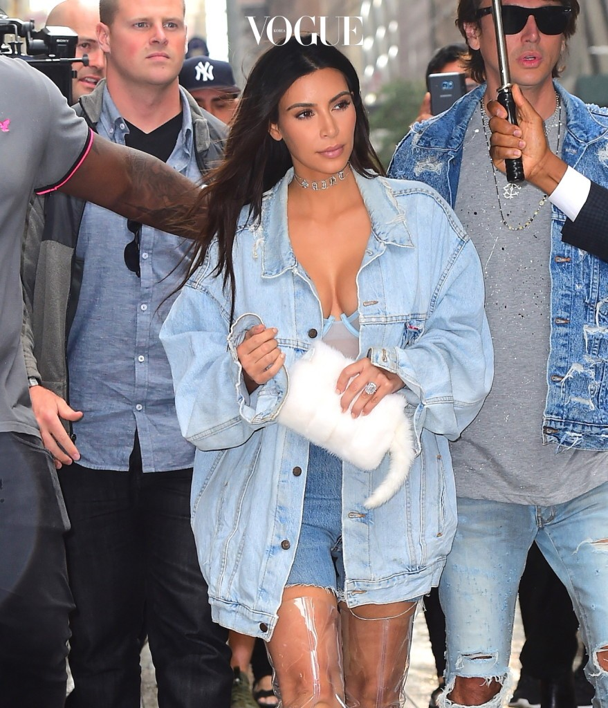 Kim Kardashian and BFF Jonathan Cheban were spotted filming for Keeping Up with the Kardashians in NYC on Tuesday afternoon. The two wore matching Double Denim as they were caught in a rain storm. They were escorted by burly security guards, and an umbrella holder as they left a midtown office building. Kim wore clear Yeezy Knee High boots. She was caught off guard when a huge gust of wind blew all of her hair across her face, before they made it to their car. Pictured: Kim Kardashian, Jonathan Cheban Ref: SPL1347263  060916   Picture by: 247PAPS.TV / Splash News Splash News and Pictures Los Angeles:310-821-2666 New York: 212-619-2666 London:870-934-2666 photodesk@splashnews.com