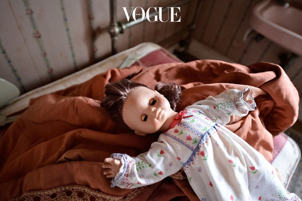 HARROGATE, ENGLAND - SEPTEMBER 04:  A doll in one of the bedrooms in Pineheath house on September 4, 2013 in Harrogate, England. The untouched 40-bedroom house belonged to wealthy Indian-born aristocrats Sir Dhunjibhoy and Lady Bomanji,  who were well-known figures in British high society at the start of the 20th century and were friends of the Royal Family.  Sir Dhunjibhoy was a Bombay-based shipping magnate who also used his wealth to support Britain's war effort against the Nazis which led to him being knighted. Their 12-bathroom mansion in Harrogate was where they spent each autumn after staying at their house in Windsor during the summer and spending the winters in Poona, India. The mansion has been sold in a multi-million pound sale to a local businessman who plans to make it a family home again after Lady Bomanjis' daughter, Mrs Mehroo Jehangir, died in 2012 having not touched it since 1986, when her mother died.  (Photo by Bethany Clarke/Getty Images)
