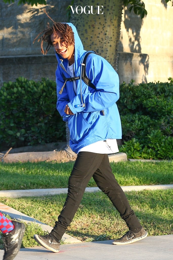 UK CLIENTS MUST CREDIT: AKM-GSI ONLY EXCLUSIVE: Singer, Jaden Smith, was in a great spirits when he was spotted walking with a couple of friends. The usually camera shy actor originally hid from the camera but quickly changed his mind and gave a peace sign and a bright smile as he walked. Pictured: Jaden Smith Ref: SPL1039569  290515   EXCLUSIVE Picture by: AKM-GSI / Splash News