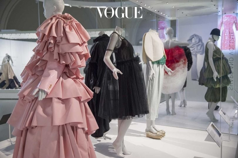 "View of an installation at the ""Balenciaga: Shaping Fashion"" exhibition, showing his influence on generations of designers including Rei Kawakubo of Comme des Garçons (front left, in pink)"
