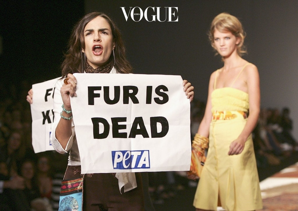 LONDON - SEPTEMBER 18:  Anti-fur protestors from Peta are seen on the runway at the Julien MacDonald fashion show as part of London Fashion Week Spring/Summer 2006 at the BFC Tent at the Natural History Museum on September 18, 2005 in London, England.  (Photo by MJ Kim/Getty Images)