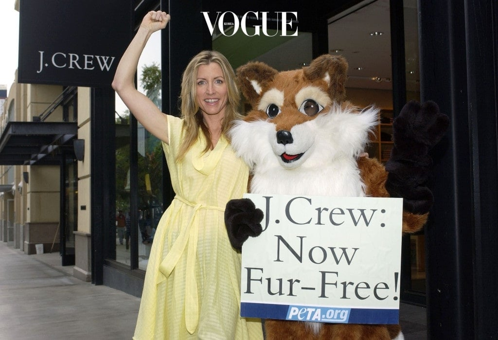 SANTA MONICA, CA - DECEMBER 1:  Animal rights activistm, Heather Mills McCartney, gestures while leading a PETA celebration as retailer J.Crew ends fur sales on December 1, 2005 in Santa Monica, California. McCartney helped launch an 11-week boycott campaign with a protest outside J. Crew's Madison Avenue store in New York on September 12.  (Photo by Amanda Edwards/Getty Images)