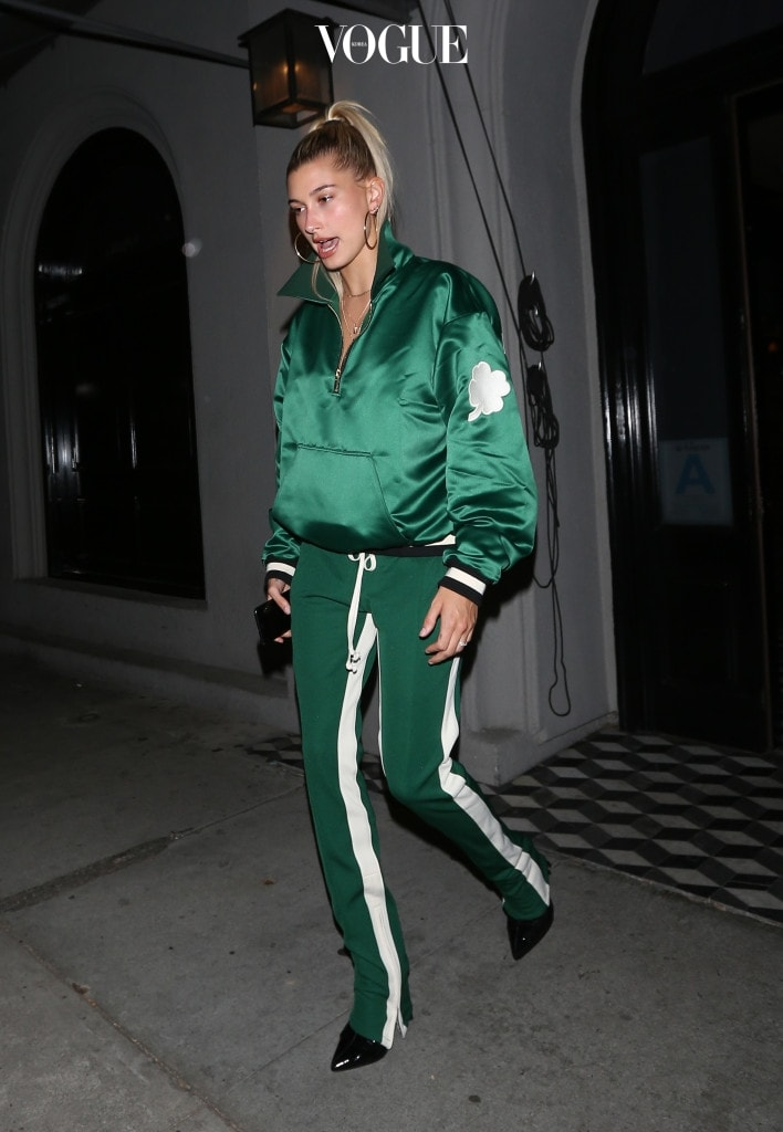 Hailey Baldwin wears a all green outfit with a shamrock patch on her left sleeve as she leaves Craig's restaurant after having dinner in West Hollywood. Pictured: Hailey Baldwin Ref: SPL1512281  030617   Picture by: Photographer Group / Splash News Splash News and Pictures Los Angeles:310-821-2666 New York:212-619-2666 London:870-934-2666 photodesk@splashnews.com