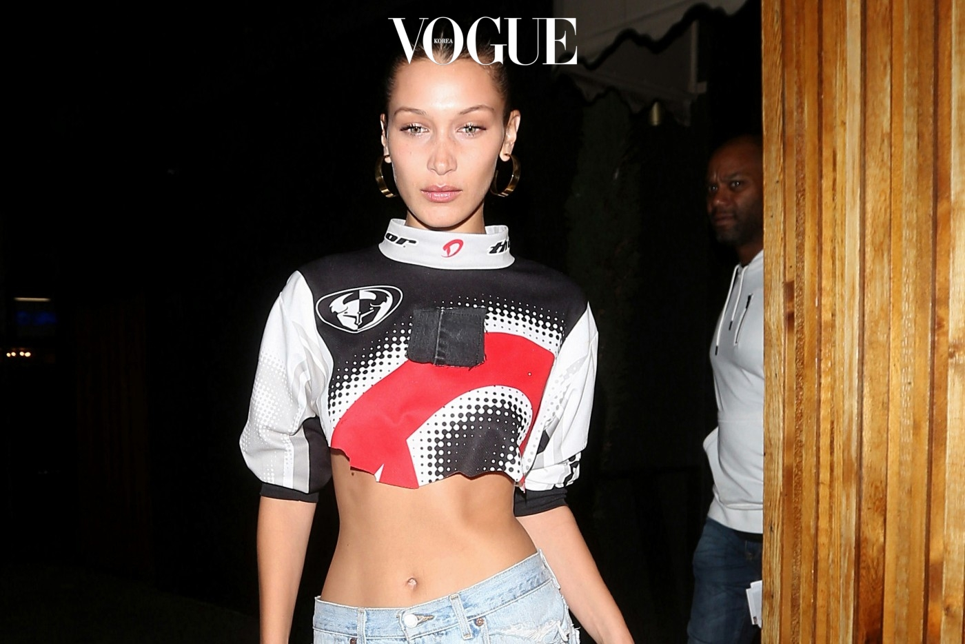 Bella Hadid shows off her midriff in a cut off shirt and jeans as she leaves the Nice Guy club after partying with Drake in West Hollywood. Bella arrived to the Nice Guy club at 1:20 A.M. and drake arrived at 12:45 A.M. Bella Hadid left from the front door of the Nice Guy club at 4 A.M. in the morning in one of Drake's SUV while Drake left from the back at the same time. As Bella gets into the car, you can clearly see her bra underneath her shirt.  Pictured: Bella Hadid Ref: SPL1523336  200617   Picture by: Photographer Group / Splash News  Splash News and Pictures Los Angeles:310-821-2666 New York:212-619-2666 London:870-934-2666 photodesk@splashnews.com
