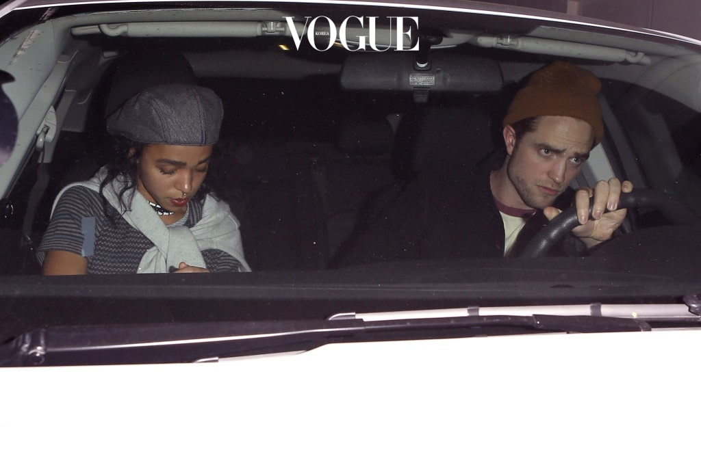 UK CLIENTS MUST CREDIT: AKM-GSI ONLY Couple Robert Pattinson and FKA Twigs attended A Benefit For The People of Nepal held at Largo at the Coronet in Los Angeles.  The rumored bride-to-be gives us a glimpse of her sparkling diamond ring as she leaves through the venue's private exit. Pictured: Robert Pattinson and FKA Twigs Ref: SPL1019345  060515   Picture by: AKM-GSI / Splash News