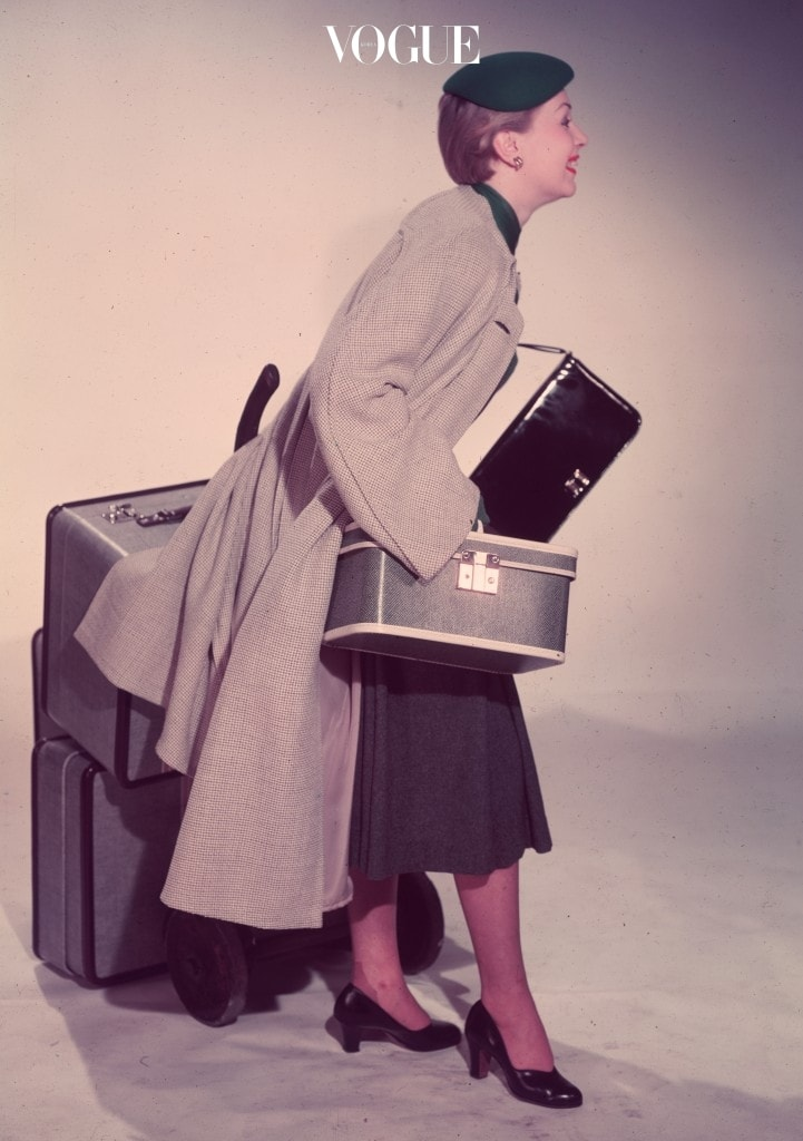 circa 1955:  A woman starts off on a journey with a full set of luggage - two suitcases, a handbag and a beauty case.  (Photo by Chaloner Woods/Getty Images)