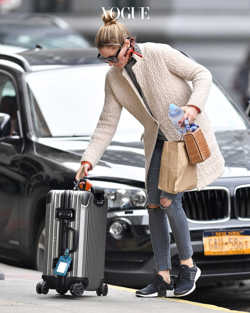 EXCLUSIVE: Olivia Palermo wears a scarf while rolling her luggage in Brooklyn, New York. Pictured: Olivia Palermo  Ref: SPL1478909  160417   EXCLUSIVE Picture by: Frank Sullivan/Splash News Splash News and Pictures Los Angeles:310-821-2666 New York:212-619-2666 London:870-934-2666 photodesk@splashnews.com