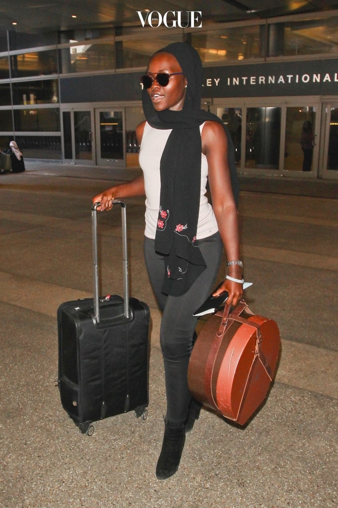 ***MANDATORY BYLINE TO READ INFPhoto.com ONLY*** Lupita Nyong'o at LAX Airport, Los Angeles, CA. Pictured: Lupita Nyong'o Ref: SPL1078581  130715   Picture by: INFphoto.com