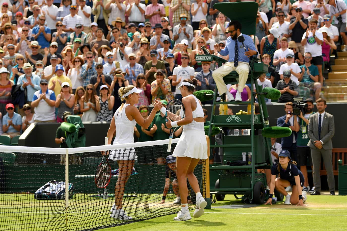 LONDON, ENGLAND - JULY 10:  Garbine Muguruza of Spain and Angelique Kerber of Germany shake hands after the Ladies Singles fourth round match on day seven of the Wimbledon Lawn Tennis Championships at the All England Lawn Tennis and Croquet Club on July 10, 2017 in London, England.  (Photo by Shaun Botterill/Getty Images)