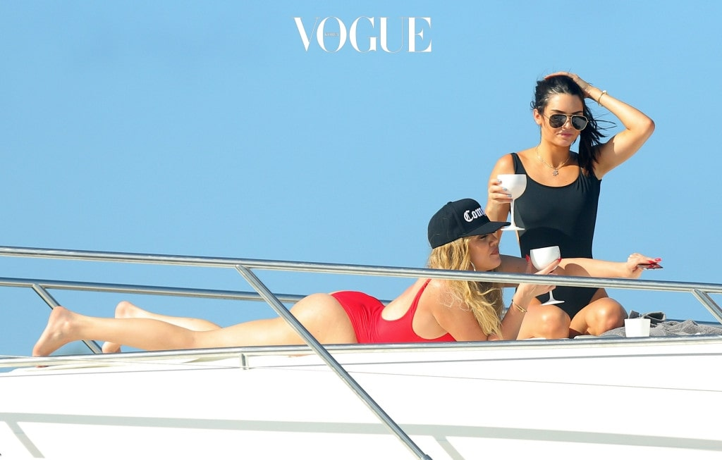 EXCLUSIVE: **PREMIUM EXCLUSIVE RATES APPLY** Khloe Kardashian and Kendall Jenner play around and take selfies on a boat in St Bart's