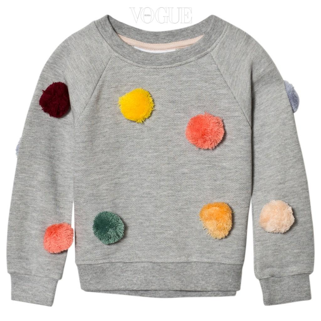 컬러풀한 폼폼 장식이 돋보이는 스웨트 셔츠는 몰로(Molo).