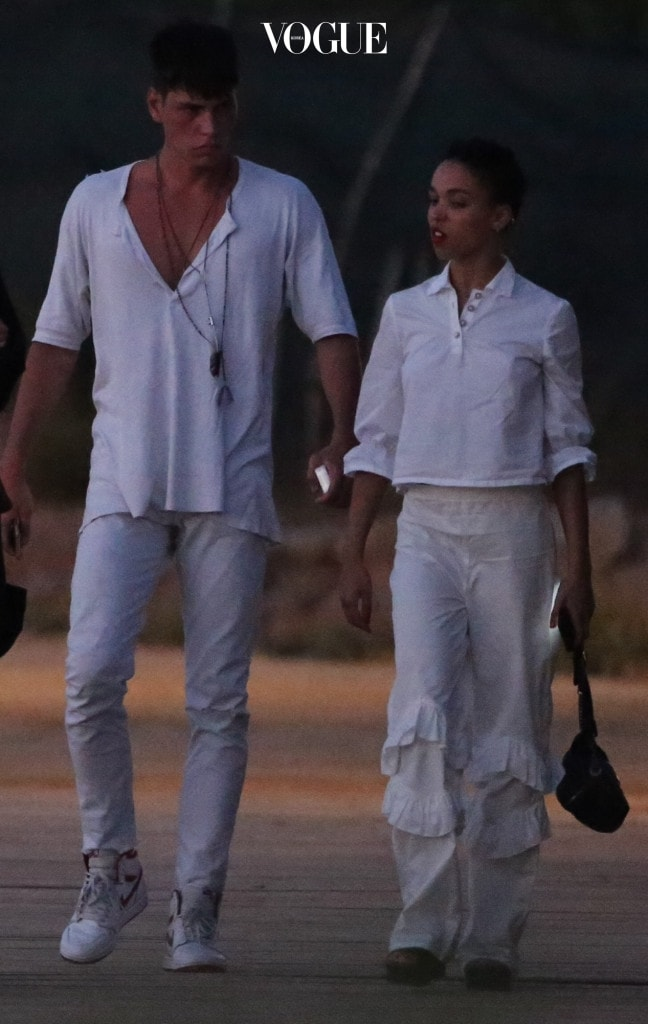 "EXCLUSIVE: **PREMIUM EXCLUSIVE RATES APPLY** NO WEB TILL 9.15PM PST 11th AUGUST 2017* FKA Twigs steps out with a hunky French male model amid rumours fiance Robert Pattinson is dating Katy Perry.  The 29-year-old singer - real name Tahliah Barnett - jetted off to Ibiza with Brieuc Breitenstein just days after Twilight star Pattinson was spotted at dinner with Perry. The 6ft 3ins model, who is thought to originally be from Paris and now lives in London, was seen cosying up to her as they went sightseeing on the Spanish island.  And there was no sign of the engagement ring that Pattinson is said to have given to her. They got caught in a rainstorm at one point - and were seen going out the previous night in matching white outfits. An onlooker said: ""They looked like a couple."" FKA Twigs and Robert, 31, reportedly got engaged in 2015. But as recently as last month he admitted they were ""kind of engaged"" as he chatted on Sirius XM's The Howard Stern radio show. Pictured: FKA Twigs, Brieuc Breitenstein Ref: SPL1554480  110817   EXCLUSIVE Picture by: Splash News Splash News and Pictures Los Angeles:310-821-2666 New York:212-619-2666 London:870-934-2666 photodesk@splashnews.com"