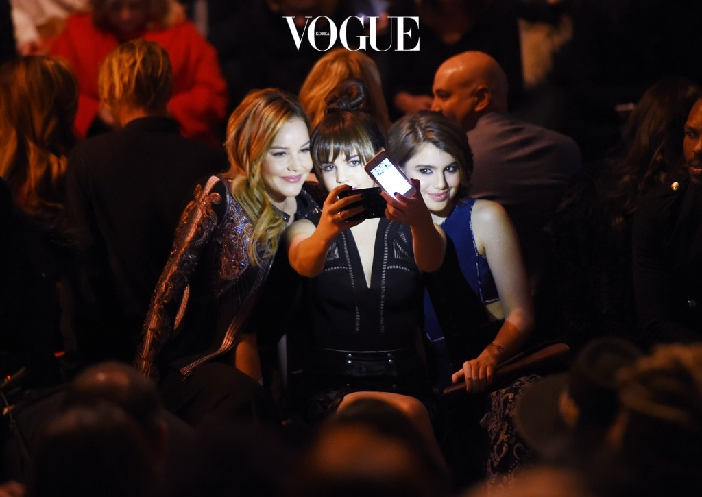 NEW YORK, NY - FEBRUARY 11:  Actresses Abbie Cornish, Bailee Madison and Sami Gayle take a selfie as they attend the front row at the BCBGMAXAZRIA Fall 2016 show during New York Fashion Week at The Arc, Skylight at Moynihan Station on February 11, 2016 in New York City.  (Photo by Nicholas Hunt/Getty Images)