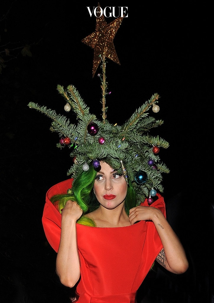 Lady Gaga wearing a red dress and a Christmas tree on her head as she arrives back at The Langham Hotel after performing at the Jingle Bell Ball.  Pictured: Lady Gaga Ref: SPL664657  081213   Picture by: Gotcha Images / Splash News Splash News and Pictures Los Angeles:310-821-2666 New York:212-619-2666 London:870-934-2666 photodesk@splashnews.com