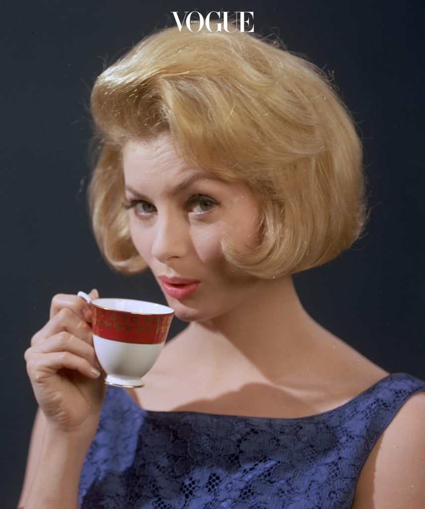 circa 1961: A well-groomed young woman quenching her thirst with a cup of strong coffee. (Photo by Chaloner Woods/Getty Images)