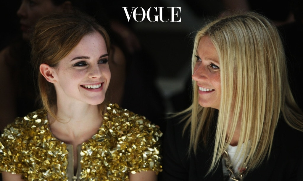 LONDON, ENGLAND - SEPTEMBER 22: Emma Watson and Gwyneth Paltrow dressed in Burberry watch the Burberry Prorsum Spring/Summer 2010 Show at Rootstein Hopkins Parade Ground during London Fashion Week on September 22, 2009 in London, England.  (Photo by Chris Jackson/Getty Images)