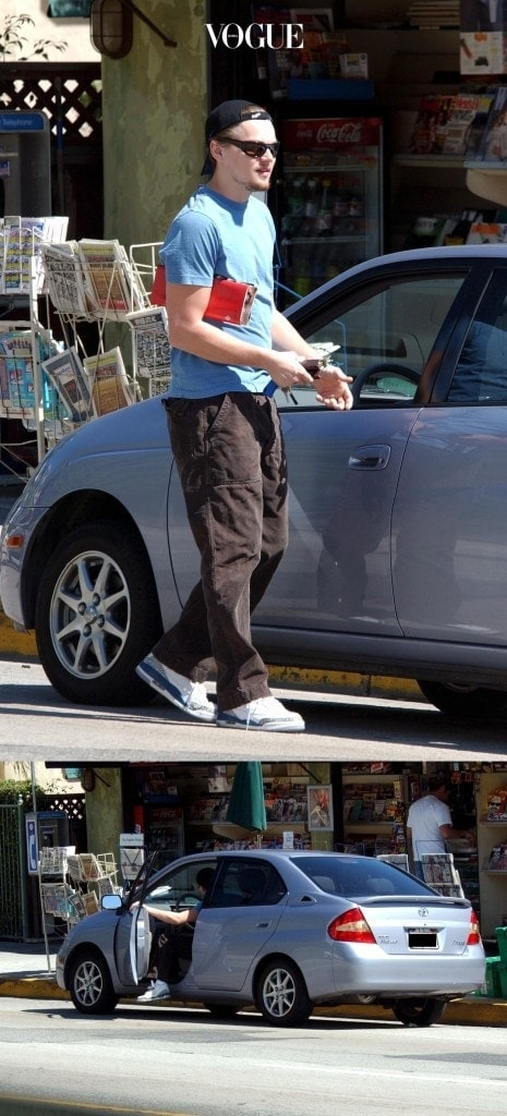 "Heartthrob Leonardo DiCaprio has given up his 'Titanic' gas-guzzler in favour of a pint-sized electric car. The 'Catch Me If You Can' star used to outrun snappers by cruising around Hollywood in a massive four-wheel drive GMC Denali - one of the biggest cars on the U.S. market that averages just 13 miles to the gallon. But now the 30-year-old actor has dumped the 5.7 litre monster for an eco-friendly run-around - and he's encouraging all Americans to do the same. DiCaprio has blasted the U.S. for driving gas-guzzlers and ignoring pollution problems. The actor has even blamed the deadly hurricanes that have lashed the country on global warming. The actor revealed his new eco-warrior attitude as he appeared on The Oprah Winfrey Show. Shown here: Actor Leonardo DiCaprio dressed in his usual baseball cap and sunglasses heads to his eco-friendly Toyota Prius after picking up some magazines at a Sunset Blvd Newspaper stand in West Hollywood, Ca. His current film ""Gangs of New York"" is nominated for several Academy Awards.  Pictures: London Entertainment / Splash Ref: LEP 180303 A Exclusive  Splash News and Pictures Los Angeles:310-821-2666 New York:212-619-2666 London:207-107-2666 photodesk@splashnews.com"