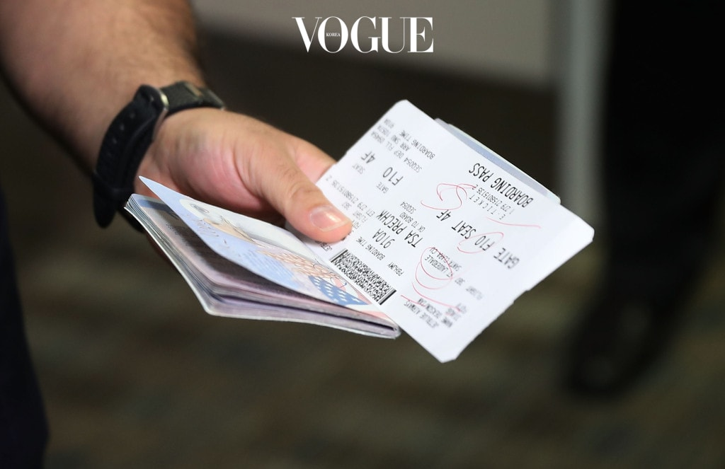 FORT LAUDERDALE, FL - AUGUST 31: A passenger holds his passport and ticket at the Fort Lauderdale-Hollywood International Airport as he checks in for JetBlue Flight 387 the first scheduled commercial flight to Cuba since 1961 on August 31, 2016 in Fort Lauderdale, Florida. JetBlue which hopes to have as many as 110 daily flights is the first U.S. airline to resume regularly scheduled airline service under new rules allowing Americans greater access to Cuba.  (Photo by Joe Raedle/Getty Images)