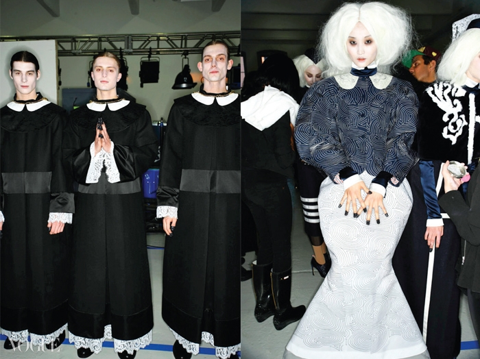 2014 가을 겨울 컬렉션백스테이지. 스태프들은 쇼직전까지 의상을 손보고,모델들은 복사와 베일을 벗은수녀로 분했다.