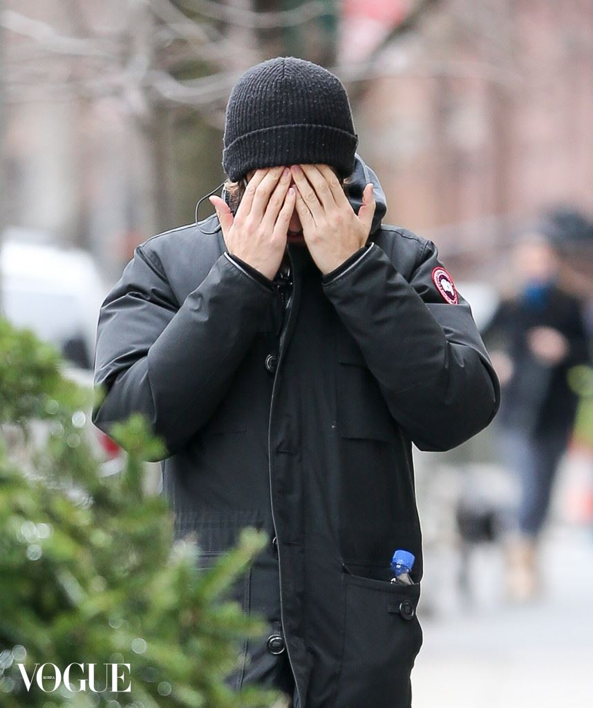 Andrew Garfield plays peek-a-boo with paparazzi while leaving Cafe Cluny in the West Village, New York City