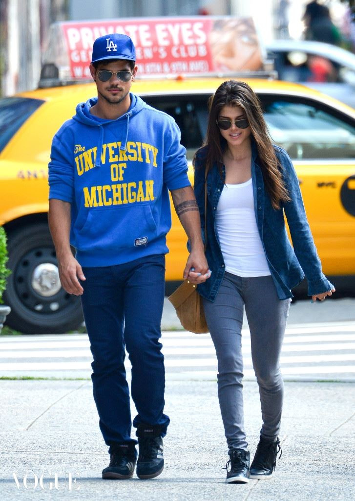 Taylor Lautner holds hands with his new girlfriend Marie Avgeropoulos in NYC