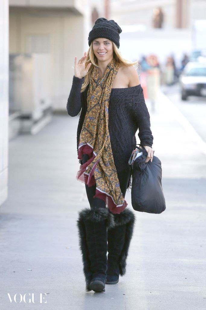 AnnaLynne McCord gets ready to fly to colder climates after a night of partying