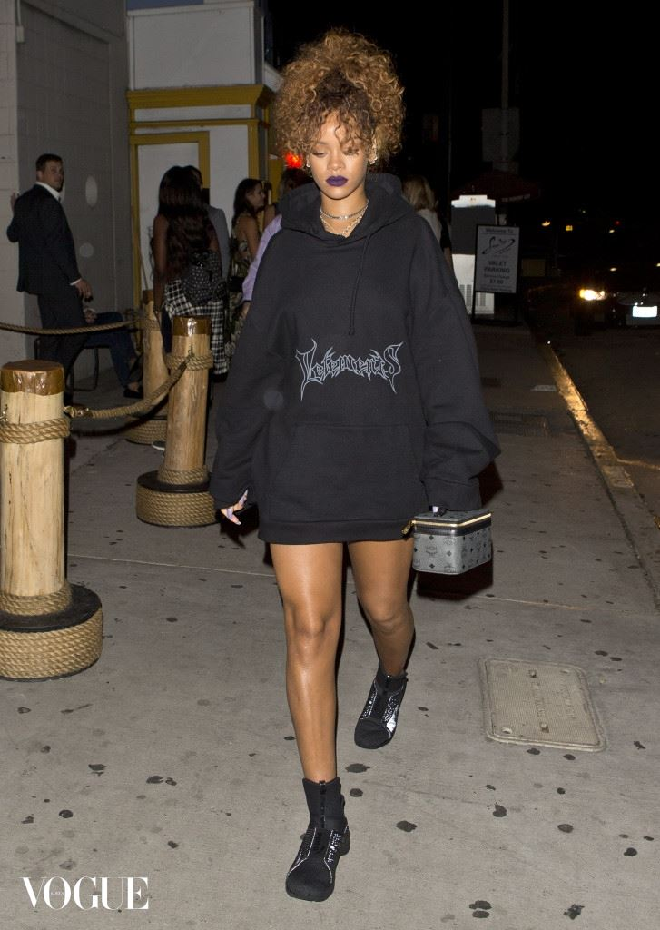 Rihanna wearing a long sweater, boots and carrying a designer Box like handbag was seen arriving at 'Giorgio Baldi' Italian Restaurant in santa Monica, CA