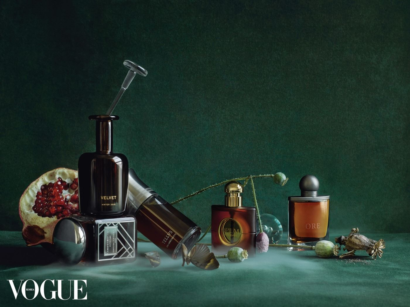 Feature, beauty, modern perfumes, addicted, spellbound, studio shot of fragrances, scents, emerald green background, decayed flowers, fruit, pomegranate