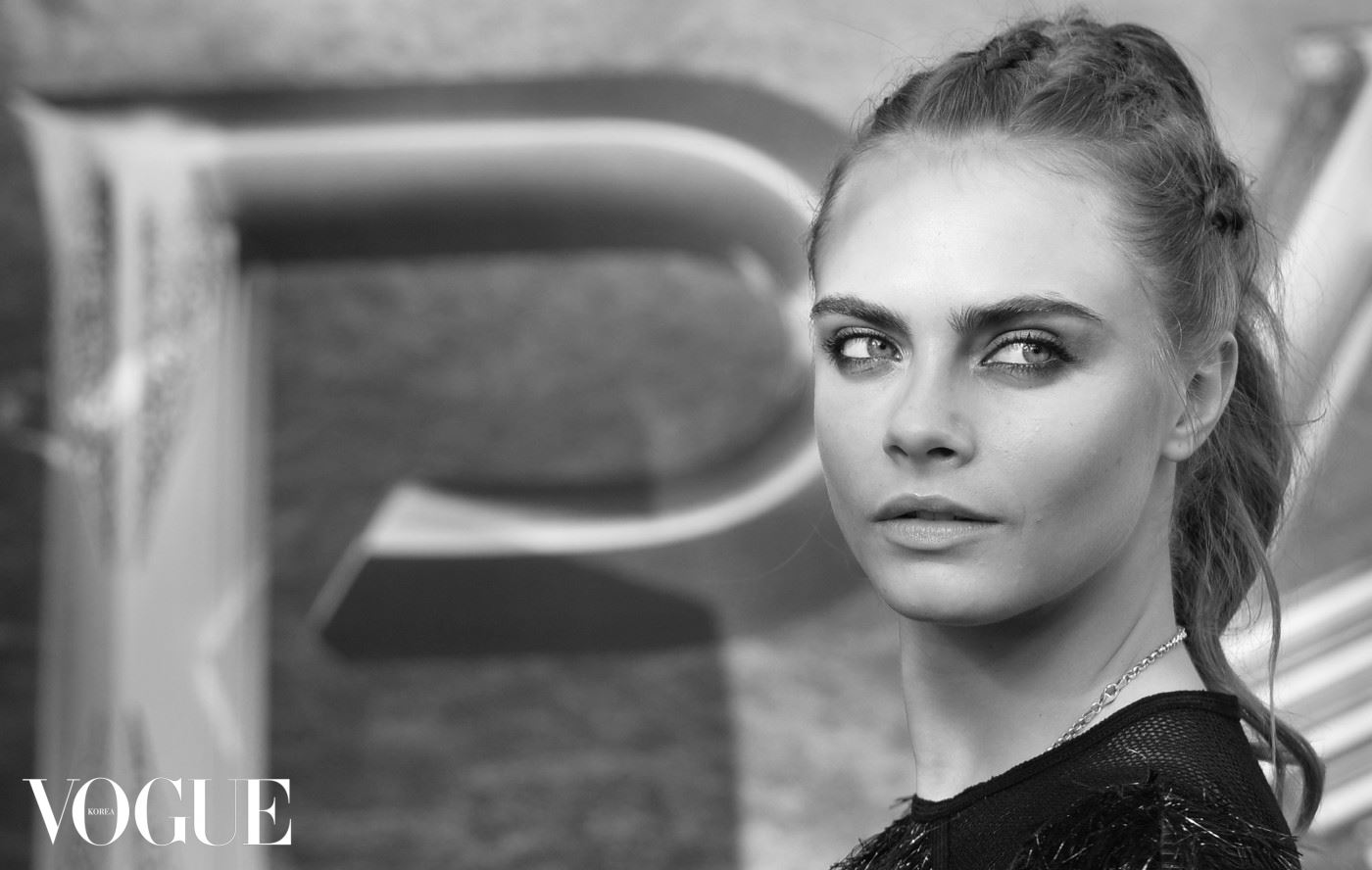 """LONDON, ENGLAND - SEPTEMBER 20:  (EDITORS NOTE: Image has been converted to black and white.) Cara Delevingne attends the World Premiere of """"Pan"""" at Odeon Leicester Square on September 20, 2015 in London, England.  (Photo by Anthony Harvey/Getty Images)"""