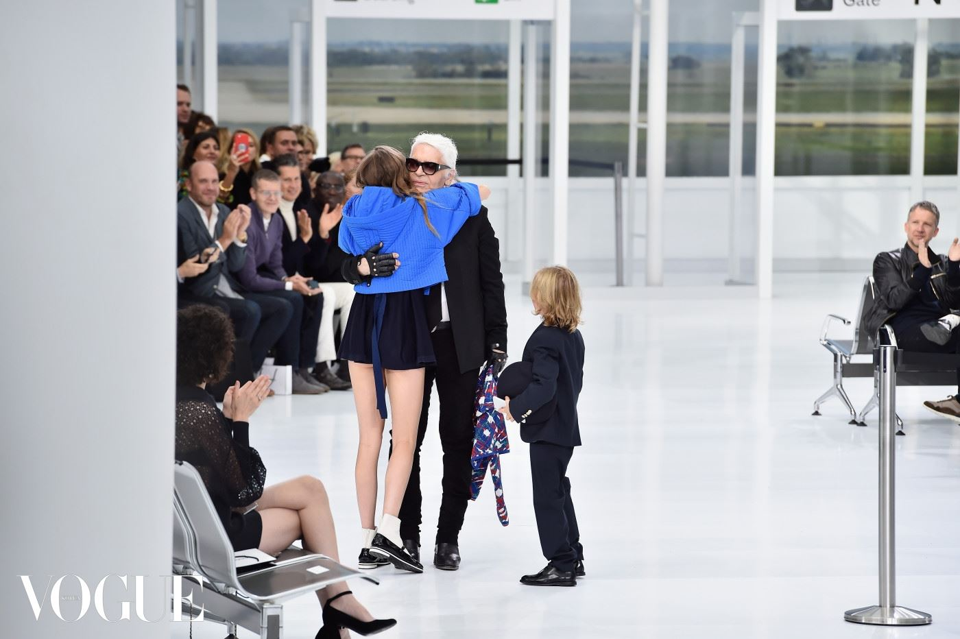 PARIS, FRANCE - OCTOBER 06:  Model Cara Delevingne and Hudson Kroenig greet the Designer Karl Lagerfeld during the Chanel show as part of the Paris Fashion Week Womenswear Spring/Summer 2016 on October 6, 2015 in Paris, France.  (Photo by Pascal Le Segretain/Getty Images)