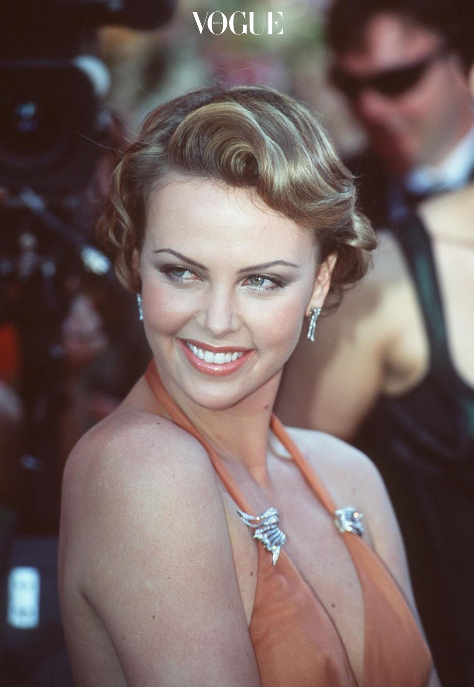 E366553 3/26/00 Los Angeles, CA. Charlize Theron at the 72nd Annual Academy Awards. Dave McNewOnline USA Inc.