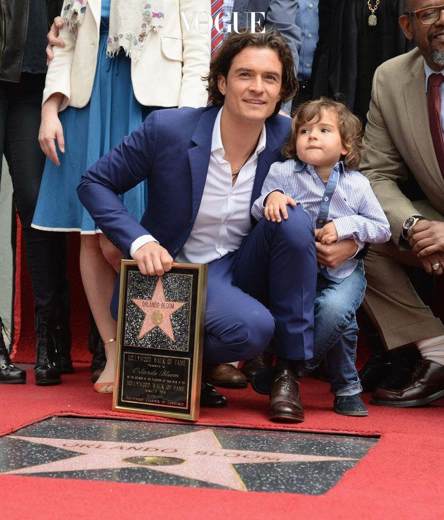 HOLLYWOOD, CA - APRIL 02:  Actor Orlando Bloom and his son Flynn Bloom attend the Hollywood Walk of Fame celebration in honor of Orlando Bloom on April 2, 2014 in Hollywood, California.  (Photo by Jason Kempin/Getty Images)