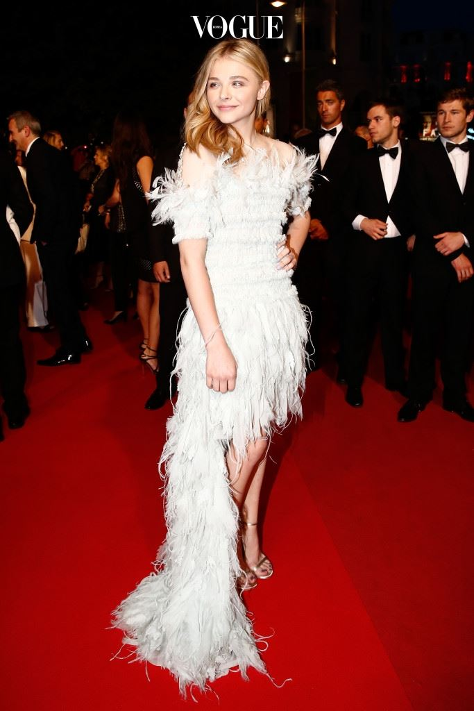 """CANNES, FRANCE - MAY 23:  Chloe Grace Moretz leaves the """"Clouds Of Sils Maria"""" premiere during the 67th Annual Cannes Film Festival on May 23, 2014 in Cannes, France.  (Photo by Andreas Rentz/Getty Images)"""