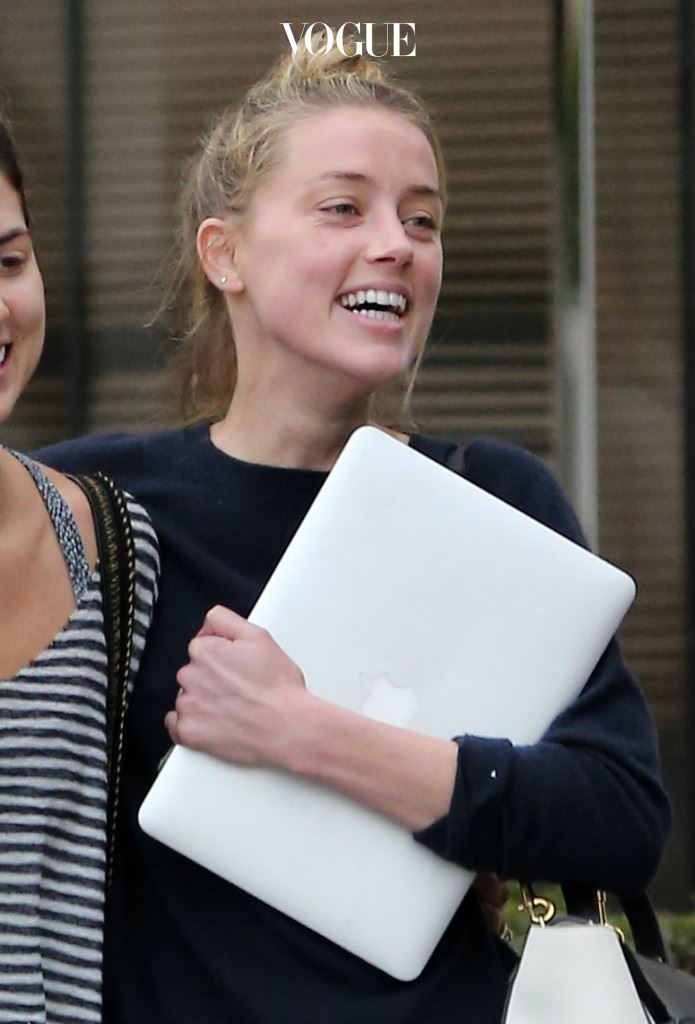 EXCLUSIVE: **PREMIUM RATES APPLY**NO WEB UNTIL 10PM PST SUNDAY MAY 29, 2016 AND NO NY PAPERS  Amber Heard is all smiles following a four-hour meeting with her legal team in Los Angeles, California. The actress, who has filed for divorce from Johnny Depp and accused him of domestic violence, laughed loudly and hugged a female friend as they left the office building and walked to a waiting limo. Heard, who was clasping a laptop computer, arrived at the office at around 3.30pm on May 28, 2016, and left at about 7.30pm. She was spotted chatting to her attorney Samantha Spector and hugging another member of her legal team inside the building. The blonde star, who was not wearing her wedding or engagement rings, threw her head back in a fit of giggles as she walked armed in arm towards the car with her pal. The bruise on her face, which she claims was inflicted by Depp, appeared less visible than it had been the previous day at court. Pictured: Amber Heard Ref: SPL1292613  290516   EXCLUSIVE Picture by: Brewer/McManus/Splash News Splash News and Pictures Los Angeles:310-821-2666 New York:212-619-2666 London:870-934-2666 photodesk@splashnews.com