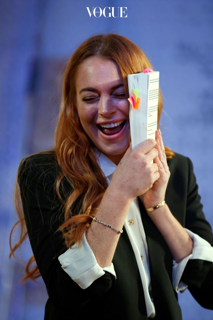 """LONDON, ENGLAND - SEPTEMBER 30:  Lindsay Lohan performs during a photocall for """"Speed The Plow"""" at Playhouse Theatre on September 30, 2014 in London, England.  (Photo by Tim P. Whitby/Getty Images)"""