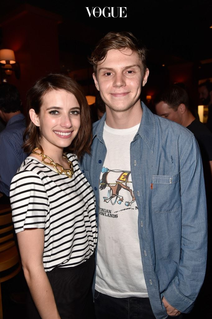 SAN DIEGO, CA - JULY 26:  Actors Emma Roberts and Evan Peters attend Twentieth Century Fox Television's Comic-Con Stars & Producers Cocktail Party during Comic-Con International 2014 at Pizzeria Mozza on July 26, 2014 in San Diego, California.  (Photo by Frazer Harrison/Getty Images)