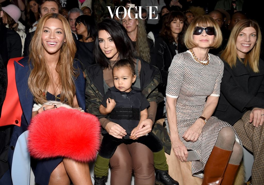 NEW YORK, NY - FEBRUARY 12:  (L-R) Beyonce, Kim Kardashian with daughter North and Anna Wintour attend the adidas Originals x Kanye West YEEZY SEASON 1 fashion show during New York Fashion Week Fall 2015 at Skylight Clarkson Sq on February 12, 2015 in New York City.  (Photo by Dimitrios Kambouris/Getty Images for adidas)