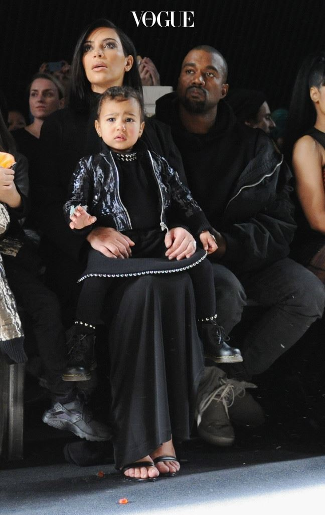 NEW YORK, NY - FEBRUARY 14:  (L-R) Kim Kardashian, North West and Kanye West attend the Alexander Wang Fashion Show during Mercedes-Benz Fashion Week Fall 2015 at Pier 94 on February 14, 2015 in New York City.  (Photo by Craig Barritt/Getty Images)