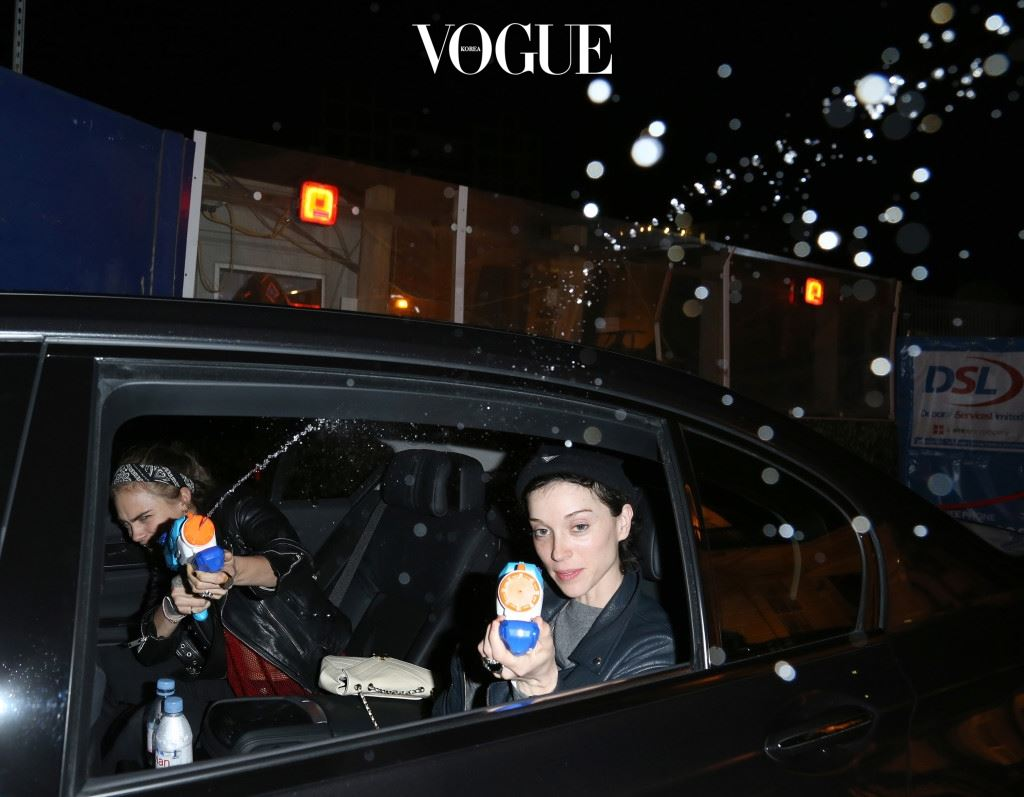 """EXCLUSIVE: Cara Delevingne and her girlfriend St. Vincent aka Annie Clark, have a hilarious time soaking photographers with pump action water pistols, as they enjoy a night out in London. The pair spent some time doing a large amount of Christmas shopping, before heading into Mayfair and stopping off at Tape Club. As they left, they bumped into a photographer, who they drenched with their water guns, screaming in delight as the shocked snapper could only laugh. The couple then headed home, and were greeted by two more photographers who were given the same treatment. Cara shouted """"take that"""" as she unleashed a torrent of water all over the snappers, and St. Vincent even continued squirting the gun as Cara searched for her keys to get in the house! The incident comes just 24hrs after Cara asked her Twitter followers how to deal with the paparazzi, and suggested that maybe she should throw eggs at them. Pics taken Dec 18th. Pictured: Cara Delevingne, St. Vincent, Annie Clark Ref: SPL1196360  211215   EXCLUSIVE Picture by: MARTI PELLOW / Splash News Splash News and Pictures Los Angeles:310-821-2666 New York:212-619-2666 London:870-934-2666 photodesk@splashnews.com"""