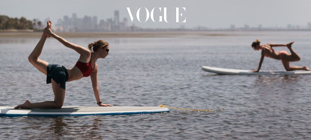 MIAMI, FL - JULY 10:  Yoga instructor Sarah Henry  leads a class during a paddleboard yoga session at Adventure Sports Miami on July 10, 2011 in Miami, Florida. The paddle board is said to give the body's core more of a workout then in a gym since the platform is unstable and one must use the muscles to remain balanced on the board.  (Photo by Joe Raedle/Getty Images)