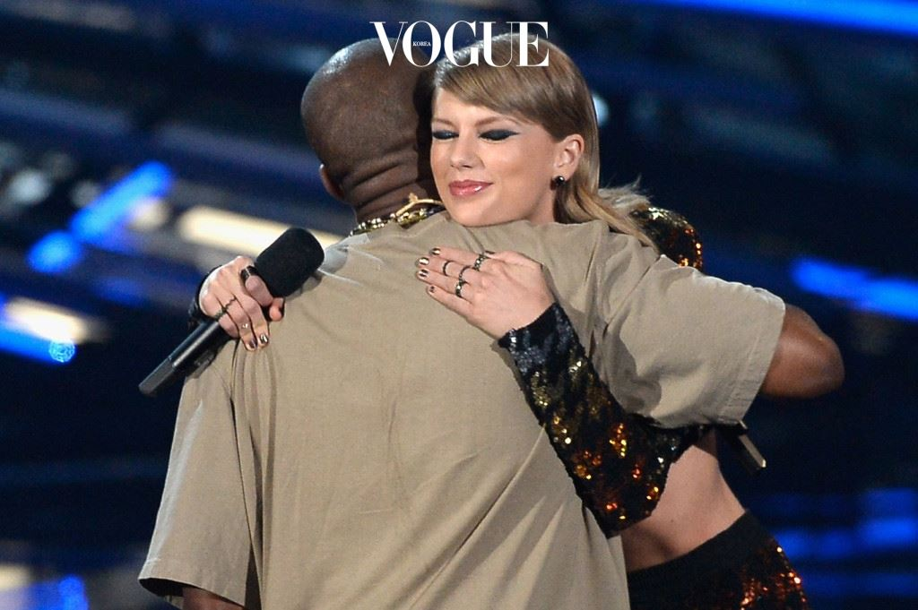 LOS ANGELES, CA - AUGUST 30:  Recording artist Kanye West (L) accepts the Video Vanguard Award from recording artist Taylor Swift onstage during the 2015 MTV Video Music Awards at Microsoft Theater on August 30, 2015 in Los Angeles, California.  (Photo by Kevork Djansezian/Getty Images)