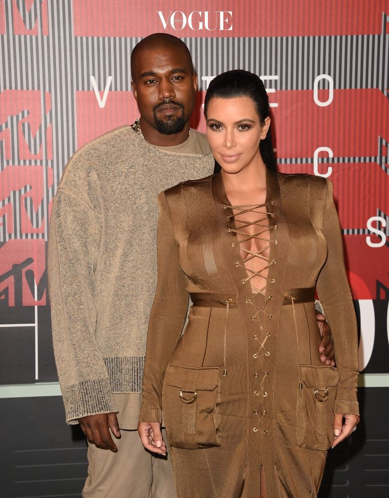 LOS ANGELES, CA - AUGUST 30:  Singer Kayne West and TV personality Kim Kardashian attend the 2015 MTV Video Music Awards at Microsoft Theater on August 30, 2015 in Los Angeles, California.  (Photo by Jason Merritt/Getty Images)