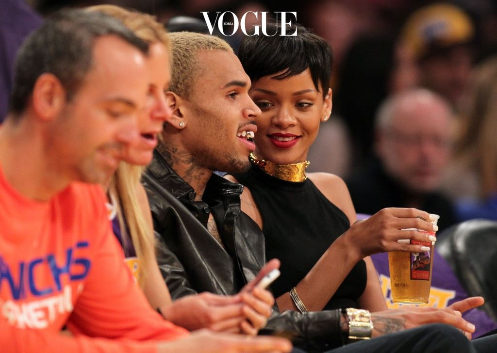 LOS ANGELES, CA - DECEMBER 25:  Recording artists Chris Brown and Rihanna attend the NBA game between the New York Knicks and the Los Angeles Lakers at Staples Center on December 25, 2012 in Los Angeles, California. The Lakers defeated the Knicks 100-94.  NOTE TO USER: User expressly acknowledges and agrees that, by downloading and or using this photograph, User is consenting to the terms and conditions of the Getty Images License Agreement. (Photo by Victor Decolongon/Getty Images)