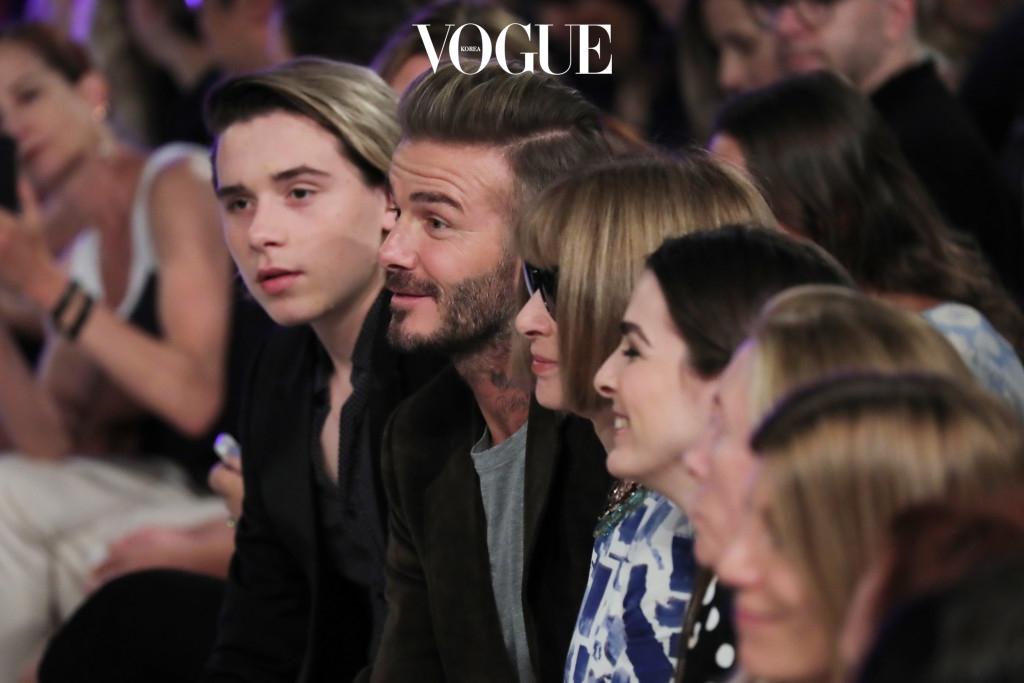 NEW YORK, NY - SEPTEMBER 11:  Brooklyn Beckham, David Beckham, and Anna Wintour attend the Victoria Beckham Spring/Summer 2017 fashion show during New York Fashion Week 2016 on September 11, 2016 in New York City.  (Photo by Neilson Barnard/Getty Images)